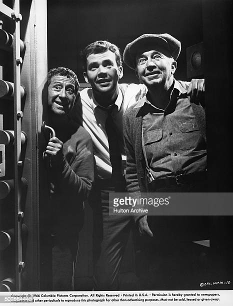 Jack Gilford Jim Hutton and Walter Brennan look on in a scene from the Columbia Pictures movieWho's Minding the Mint circa 1967