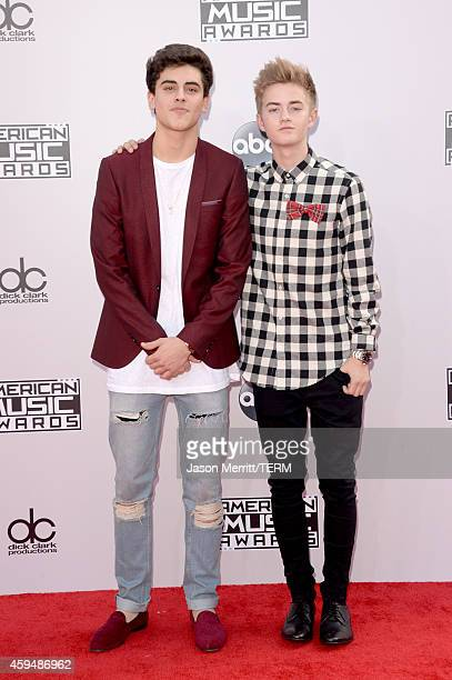 Jack Gilinsky and Jack Johnson attend the 2014 American Music Awards at Nokia Theatre LA Live on November 23 2014 in Los Angeles California