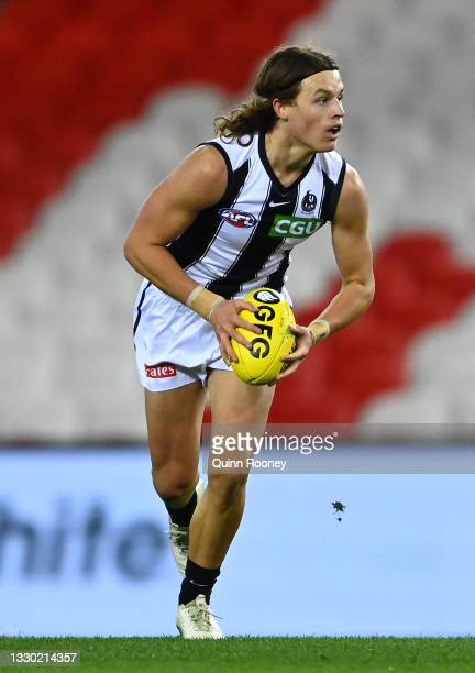 Jack Ginnivan of the Magpies looks to pass the ball during the round 19 AFL match between Port Adelaide Power and Collingwood Magpies at Marvel...