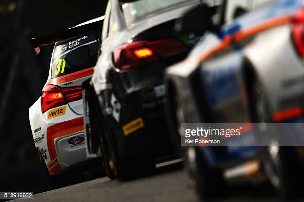 Jack Goff of Team IHG BMW heads a group of cars during race one of the Dunlop MSA British Touring Car Championship at Brands Hatch on April 3, 2016...