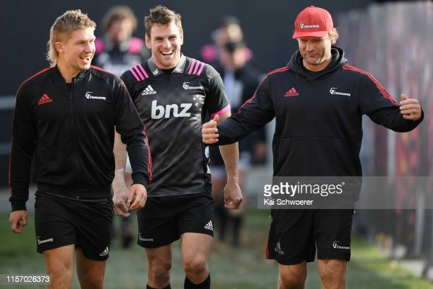 Jack Goodhue Matt Todd and Head Coach Scott Robertson react prior to a Crusaders Super Rugby Captain's Run at Orangetheory Stadium on June 20 2019 in...