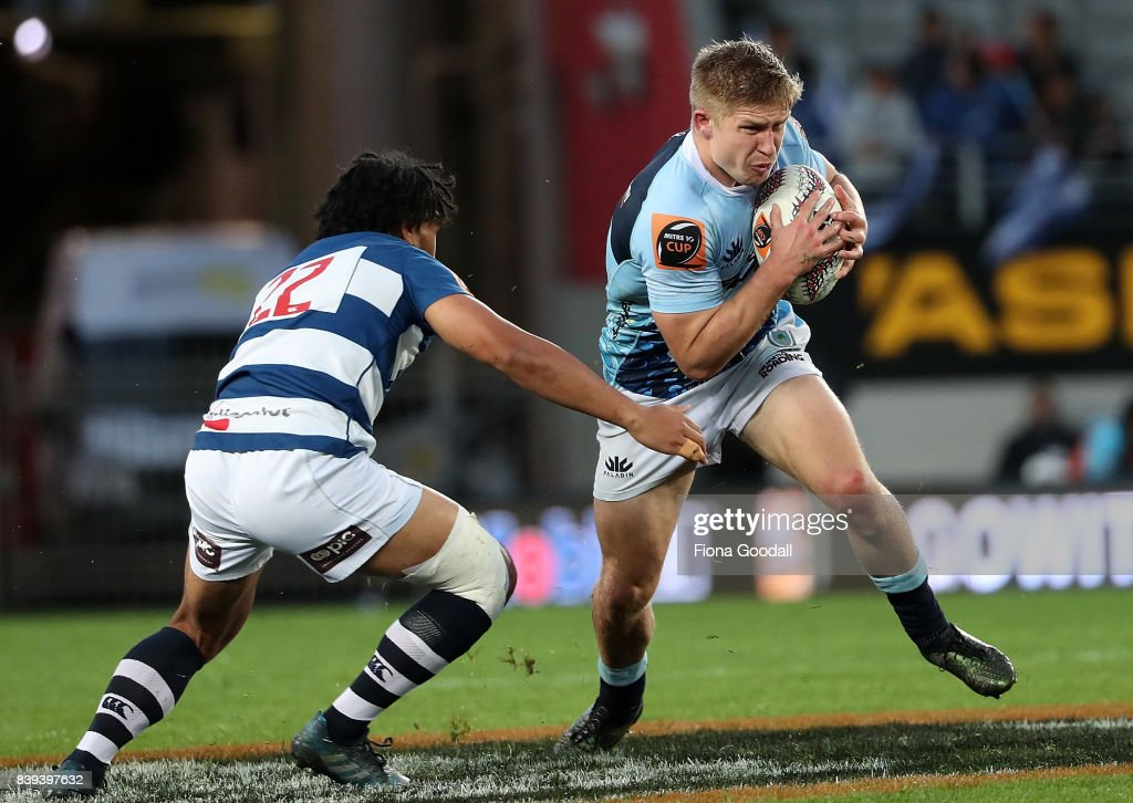 Jack Goodhue of Northland (C) is tackled by George Moala of Auckland (L) during the round two Mitre 10 Cup match between Auckland and Northland at Eden Park on August 26, 2017 in Auckland, New Zealand.