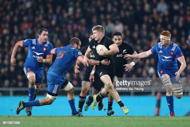 Jack Goodhue of the All Blacks makes a run during the International Test match between the New Zealand All Blacks and France at Forsyth Barr Stadium...
