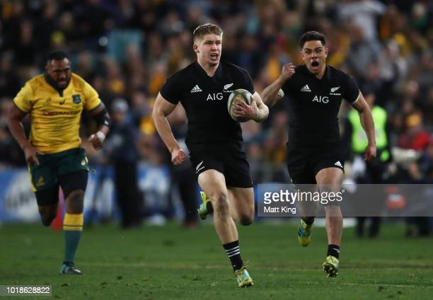 Jack Goodhue of the All Blacks runs away to score a try during The Rugby Championship Bledisloe Cup match between the Australian Wallabies and the...