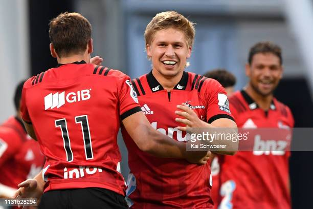 Jack Goodhue of the Crusaders celebrates after Richie Mo'unga scored a try during the round two Super Rugby match between the Crusaders and the...