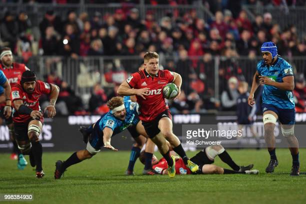 Jack Goodhue of the Crusaders charges forward during the round 19 Super Rugby match between the Crusaders and the Blues at AMI Stadium on July 14...