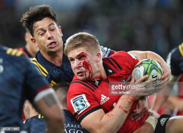 Jack Goodhue of the Crusaders is bloodied during the round five Super Rugby match between the Highlanders and the Crusaders at Forsyth Barr Stadium...