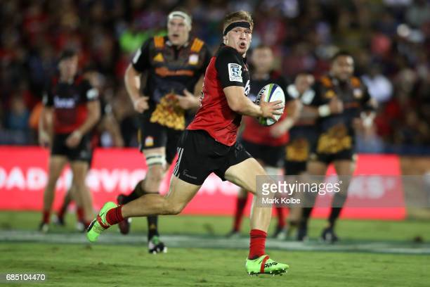 Jack Goodhue of the Crusaders makes a break during the round 13 Super Rugby match between the Chiefs and the Crusaders at ANZ Stadium on May 19 2017...
