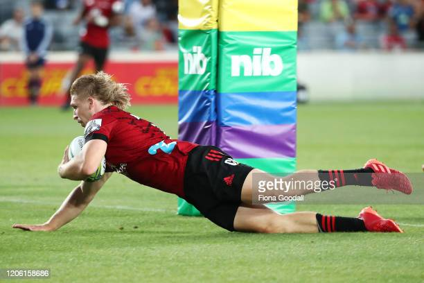 Jack Goodhue of the Crusaders scores a try during the round 3 Super Rugby match between the Blues and the Crusaders at Eden Park on February 14, 2020...