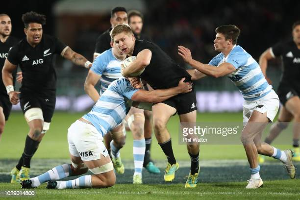 Jack Goodhue of the New Zealand All Blacks is tackled during The Rugby Championship match between the New Zealand All Blacks and Argentina at...