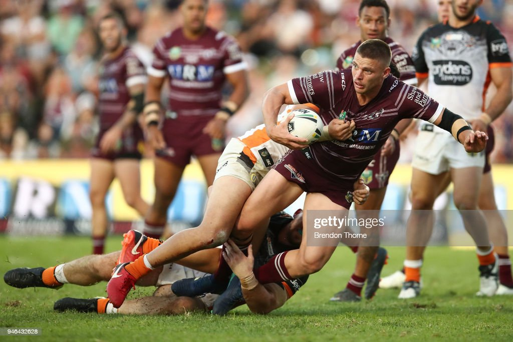 Jack Gosiewski of the Sea Eagles is tackled by the Tigers defence during the round six NRL match between the Manly Sea Eagles and the Wests Tigers at Lottoland on April 15, 2018 in Sydney, Australia.