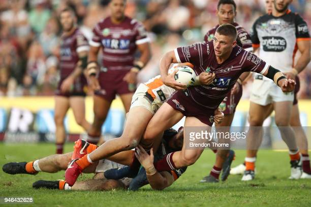 Jack Gosiewski of the Sea Eagles is tackled by the Tigers defence during the round six NRL match between the Manly Sea Eagles and the Wests Tigers at...