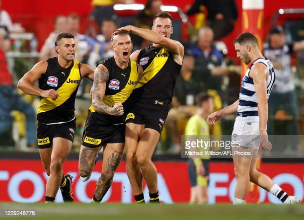 Jack Graham Dustin Martin and Noah Balta of the Tigers celebrate during the 2020 Toyota AFL Grand Final match between the Richmond Tigers and the...