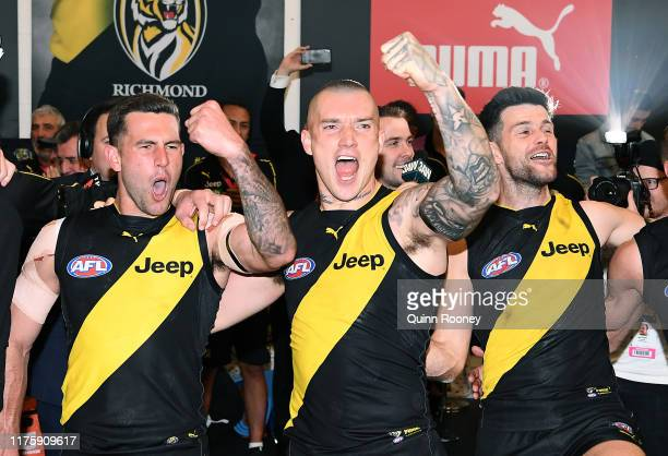 Jack Graham, Dustin Martin and Trent Cotchin of the Tigers sing the song in the rooms after winning the AFL Preliminary Final match between the...