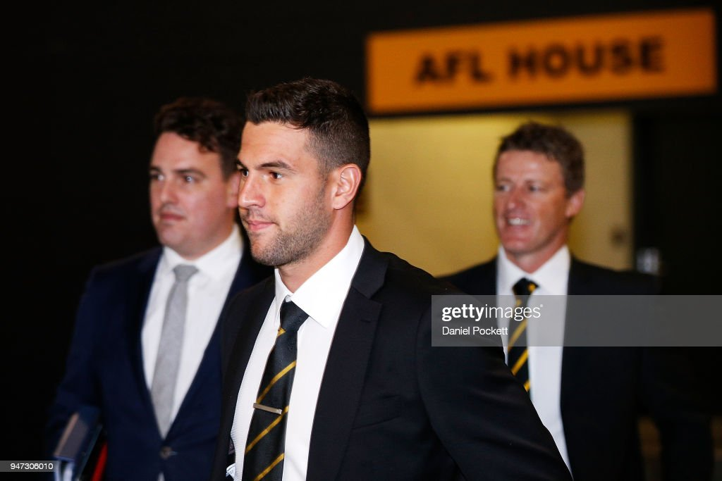 Jack Graham (middle) of the Tigers and head coach Damien Hardwick (right) arrive at the AFL Tribunal on April 17, 2018 in Melbourne, Australia.