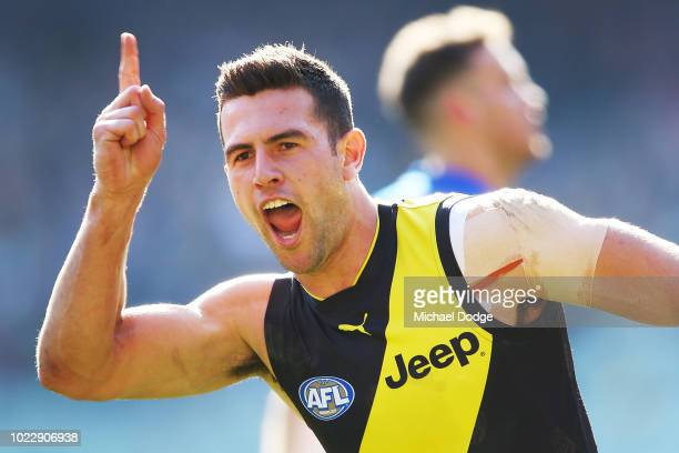 Jack Graham of the Tigers celebrates a goal during the round 23 AFL match between the Richmond Tigers and the Western Bulldogs at Melbourne Cricket...