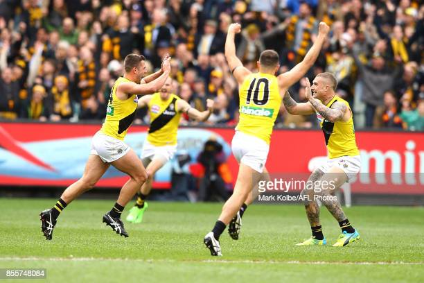 Jack Graham of the Tigers celebrates with Shane Edwards and Dustin Martin of the Tigers after he kicked a goal during the 2017 AFL Grand Final match...