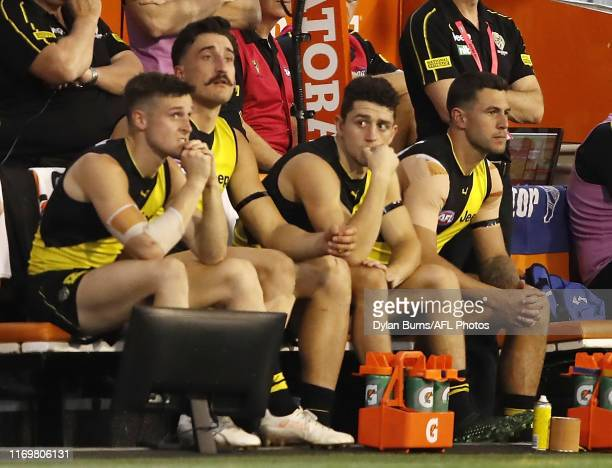 Jack Graham of the Tigers is seen on the bench after coming off the ground with an injury during the 2019 AFL Second Preliminary Final match between...
