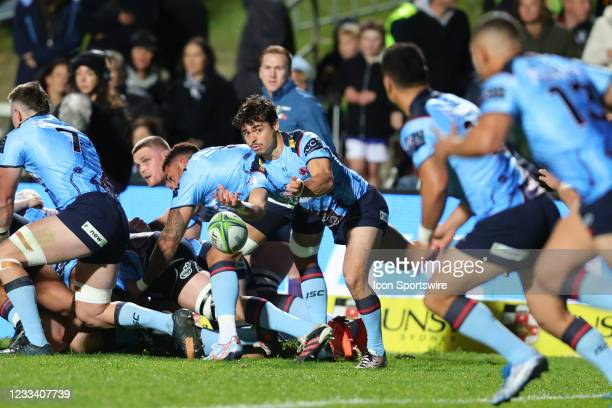 Jack Grant of the Waratahs feeds the backs during the round five Super Rugby Trans Tasman match between the NSW Waratahs and Chiefs at Brookvale Oval...