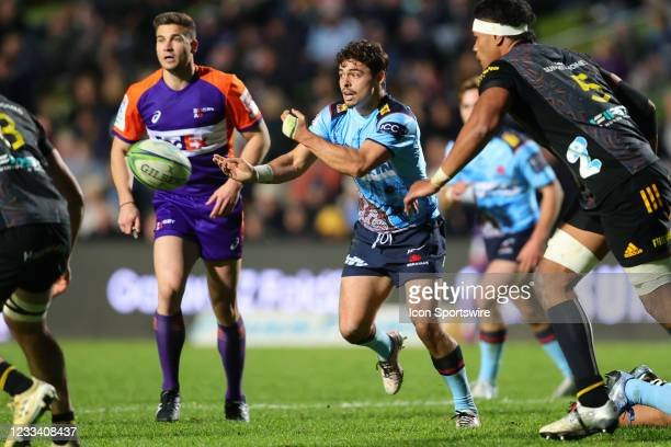 Jack Grant of the Waratahs passes the ball during the round five Super Rugby Trans Tasman match between the NSW Waratahs and Chiefs at Brookvale Oval...