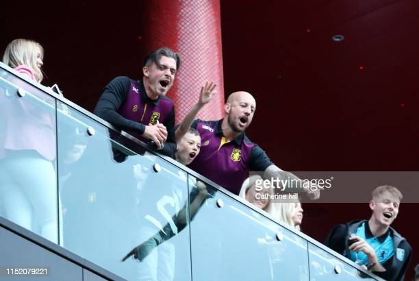 Jack Grealish and Alan Hutton of Aston Villa celebrate promotion to the Premier League from their hotel balcony infront of fans after the Sky Bet...