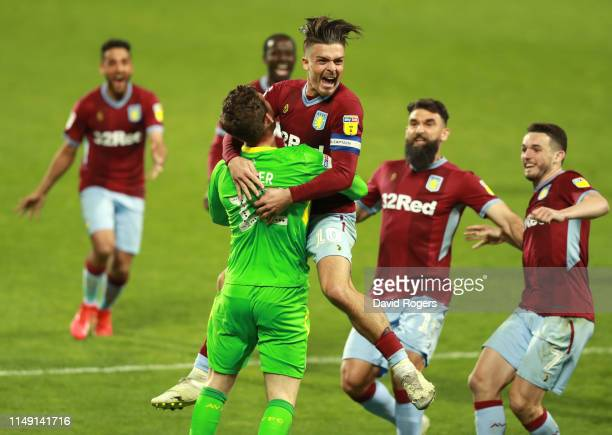 Jack Grealish and Jed Steer of Aston Villa celebrate victory in the penalty shoot out with team mates during the Sky Bet Championship Play-off semi...
