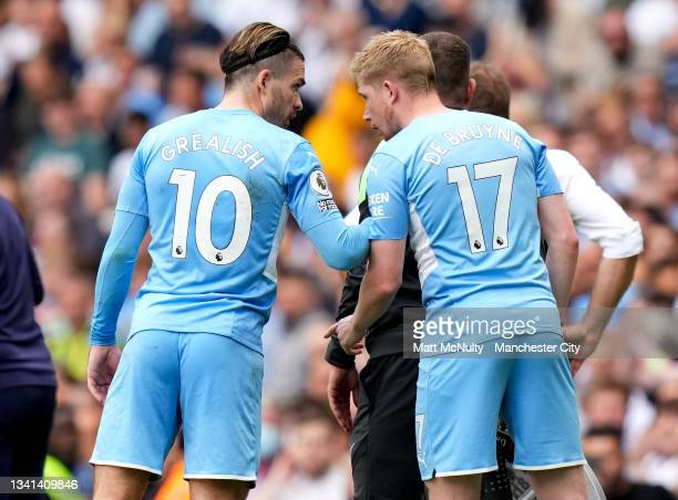 Jack Grealish and Kevin de Bruyne of Manchester City speak during the Premier League match between Manchester City and Southampton at Etihad Stadium...