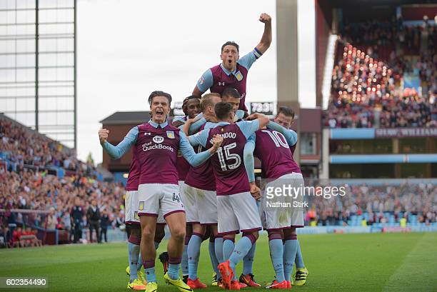 Jack Grealish and Tommy Elphick of Aston Villa celebrate their teams second goal during the Sky Bet Championship match between Aston Villa and...