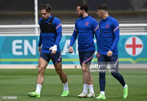 Jack Grealish, Ben Chilwell and Mason Mount of England walk out prior to the England Training Session at St George's Park on July 10, 2021 in Burton...
