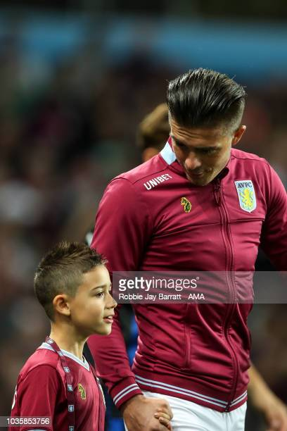 Jack Grealish of Aston Villa and a young Aston Villa mascot during the Sky Bet Championship match at Villa Park on September 18 2018 in Birmingham...