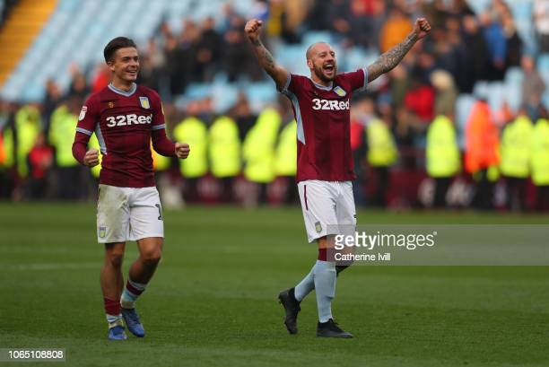 Jack Grealish of Aston Villa and Alan Hutton of Aston Villa celebrate at the end of the Sky Bet Championship match between Aston Villa and Birmingham...