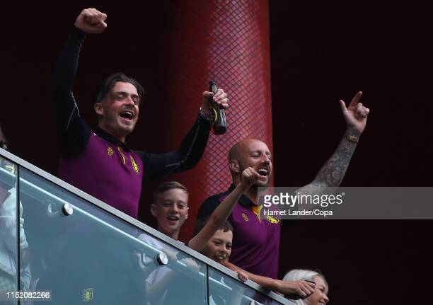 Jack Grealish of Aston Villa and Alan Hutton of Aston Villa celebrate from a hotel balcony with fans in the street following their team's victory in...