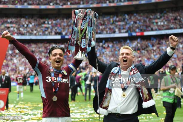 Jack Grealish of Aston Villa and Dean Smith Manager of Aston Villa celebrate with the Sky Bet Championship Playoff Final Trophy following their...
