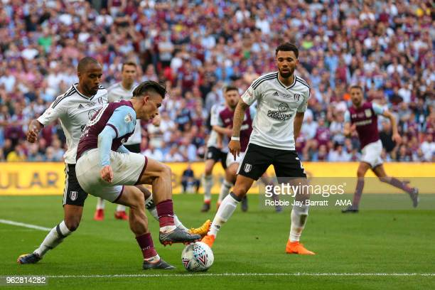 Jack Grealish of Aston Villa and Denis Odoi of Fulham during the Sky Bet Championship Play Off Final between Aston Villa and Fulham at Wembley...