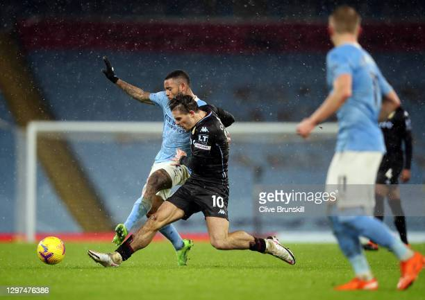Jack Grealish of Aston Villa and Gabriel Jesus of Manchester City battle for the ball during the Premier League match between Manchester City and...