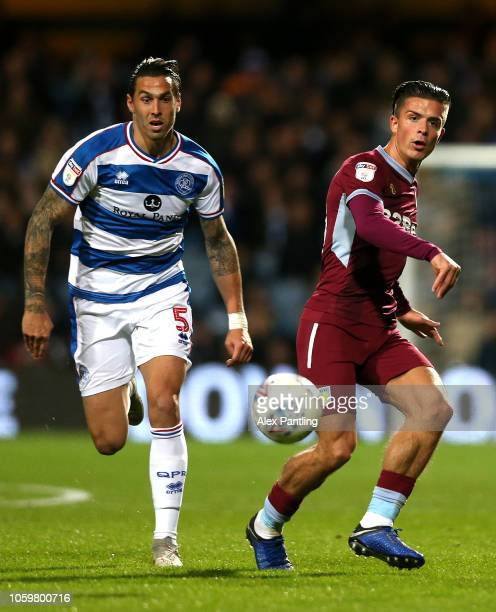 Jack Grealish of Aston Villa and Geoff Cameron of QPR during the Sky Bet Championship match between Queens Park Rangers and Aston Villa at Loftus...