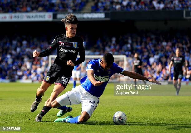 Jack Grealish of Aston Villa and Jordan Spence of Ipswich Town compete for the ball during the Sky Bet Championship match between Ipswich Town and...