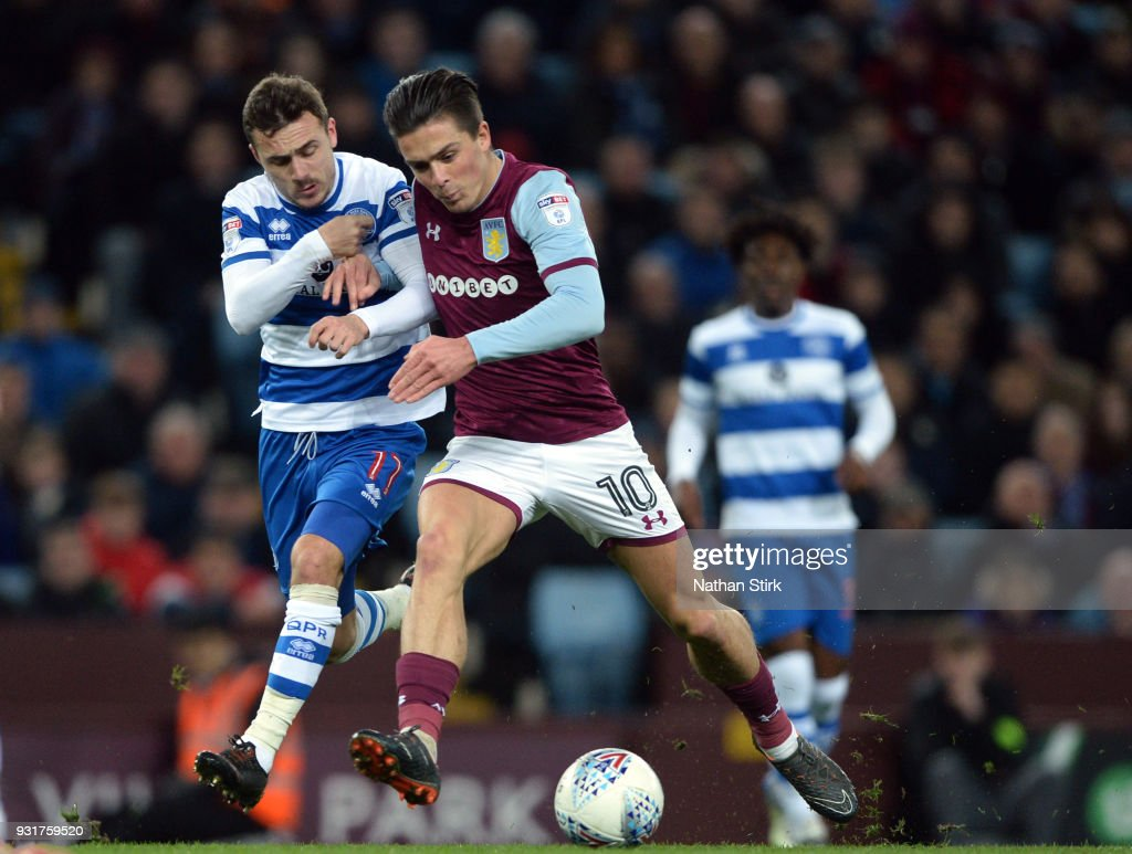 Jack Grealish of Aston Villa and of Josh Scowen of Queens Park Rangers in action during the Sky Bet Championship match between Aston Villa and Queens Park Rangers at Villa Park on March 13, 2018 in Birmingham, England.