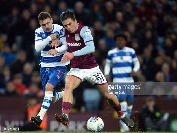 Jack Grealish of Aston Villa and of Josh Scowen of Queens Park Rangers in action during the Sky Bet Championship match between Aston Villa and Queens...