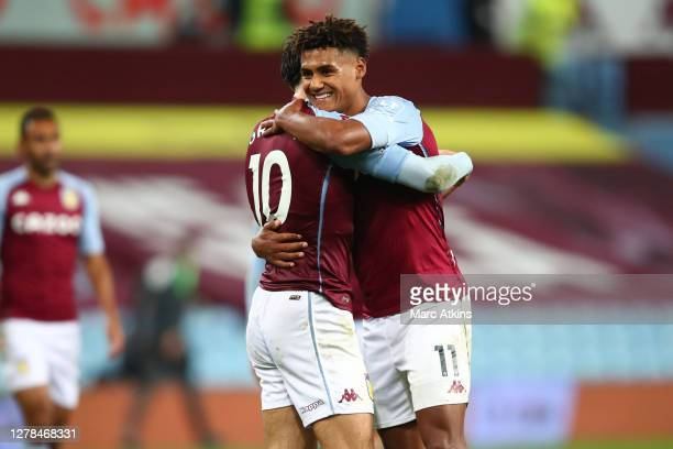 Jack Grealish of Aston Villa and Ollie Watkins of Aston Villa celebrate following their team's victory in the Premier League match between Aston...