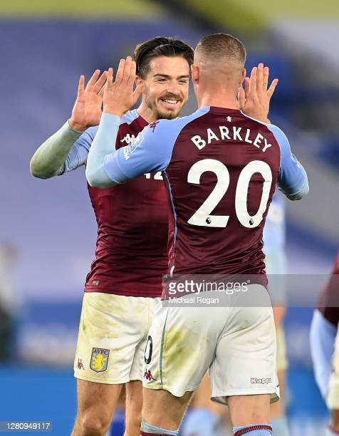 Jack Grealish of Aston Villa and Ross Barkley of Aston Villa celebrate following their sides victory in the Premier League match between Leicester...