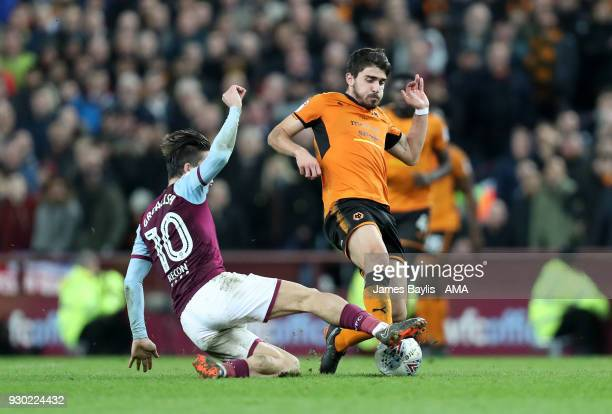 Jack Grealish of Aston Villa and Ruben Neves of Wolverhampton Wanderers during the Sky Bet Championship match between Aston Villa and Wolverhampton...