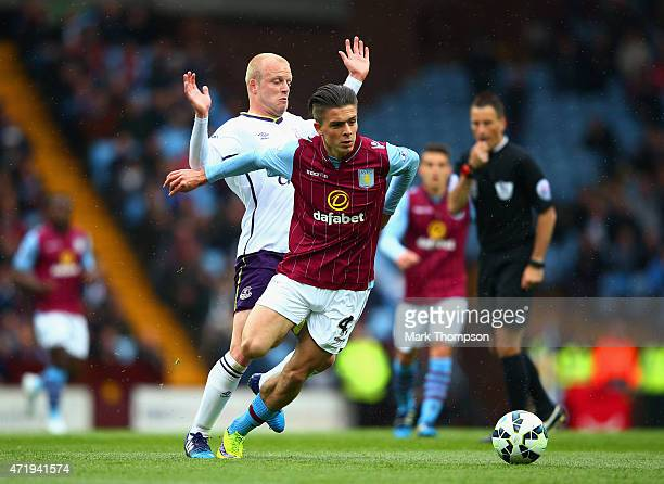 Jack Grealish of Aston Villa and Steven Naismith of Everton compete for the ball during the Barclays Premier League match between Aston Villa and...