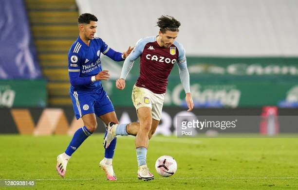 Jack Grealish of Aston Villa battles for possession with Ayoze Perez of Leicester City during the Premier League match between Leicester City and...
