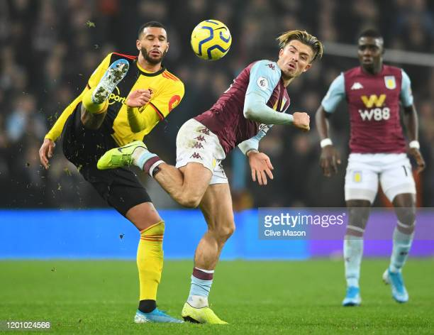 Jack Grealish of Aston Villa battles for possession with Etienne Capoue of Watford during the Premier League match between Aston Villa and Watford FC...