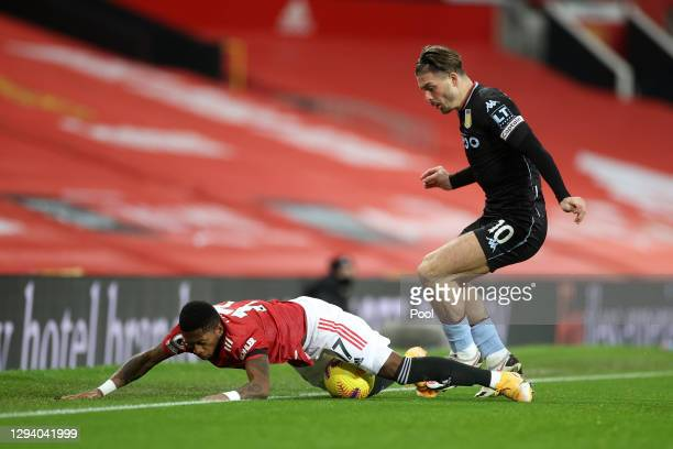 Jack Grealish of Aston Villa battles for possession with Fred of Manchester United during the Premier League match between Manchester United and...