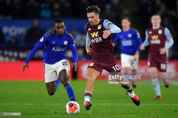 Jack Grealish of Aston Villa battles for the ball with Ricardo Pereira of Leicester City during the Premier League match between Leicester City and...