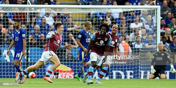 Jack Grealish of Aston Villa celebrates after opening the scoring during the Barclays Premier League match between Leicester City v Aston Villa at...