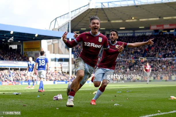 Jack Grealish of Aston Villa celebrates after scoring his sides first goal during the Sky Bet Championship match between Birmingham City v Aston...