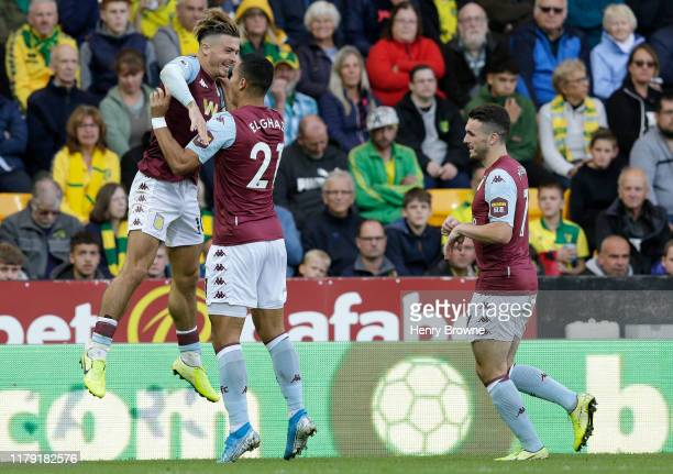 Jack Grealish of Aston Villa celebrates after scoring his sides third goal with Anwar El Ghazi of Aston Villa during the Premier League match between...